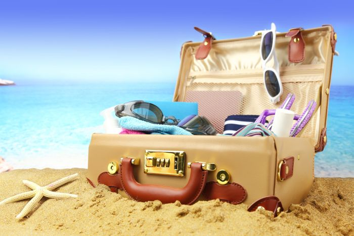 bigstock-Full-open-suitcase-on-tropical-63865936.jpg